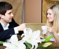 the man and the woman drink coffee at restaurant.
